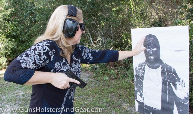 Cute Blonde Training with Pistol