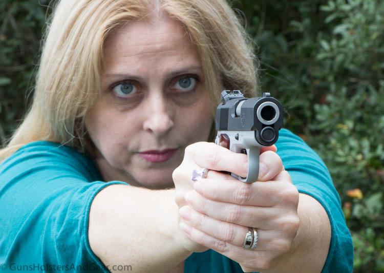 beautiful woman shooting 1911 pistol